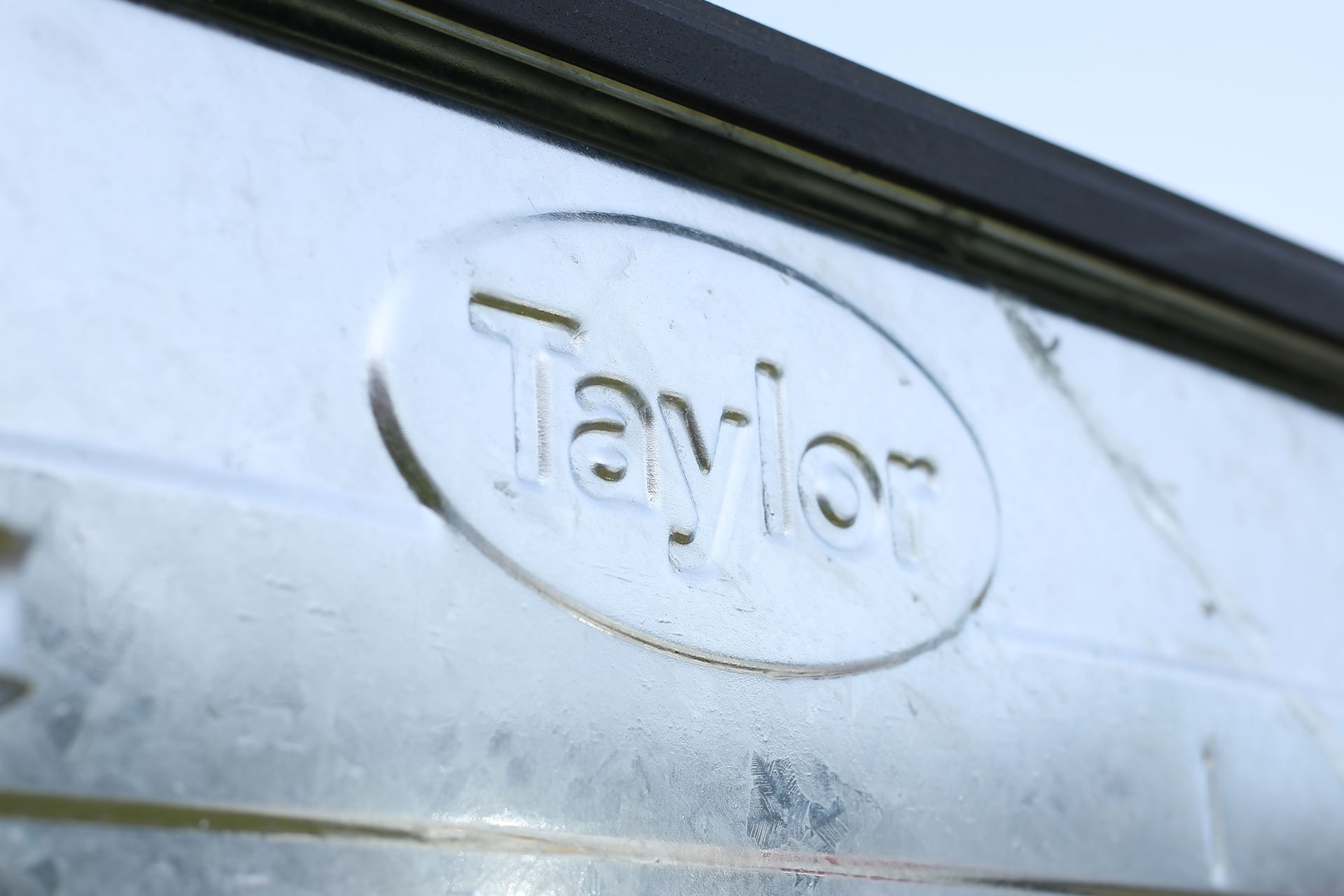 Embossed Taylor Logo